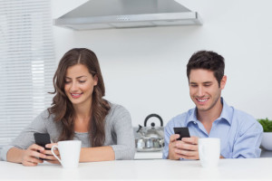 Magnetic Messaging couple using their smartphones